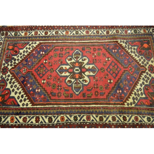 6 - Small Hamadan rug with single gol on a wine red and blue ground with multiple borders, 4ft x 3ft app...