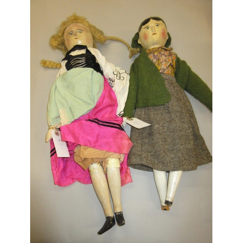 61 - Two large wooden dolls (at fault)...