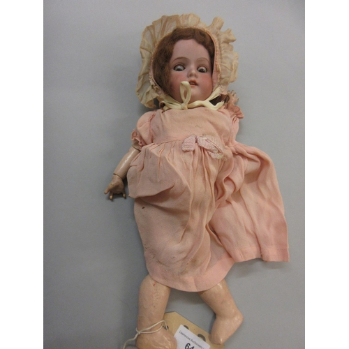 64 - Armand Marseille bisque headed doll, with sleeping eyes, open mouth and four teeth, the head marked ...