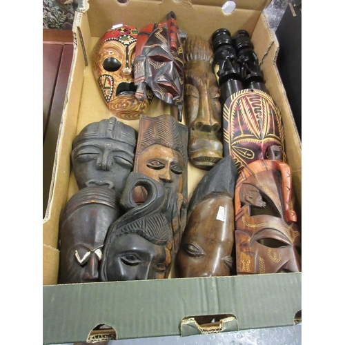 87 - Ten various small 20th Century African carved wooden wall masks together with a pair of similar carv...