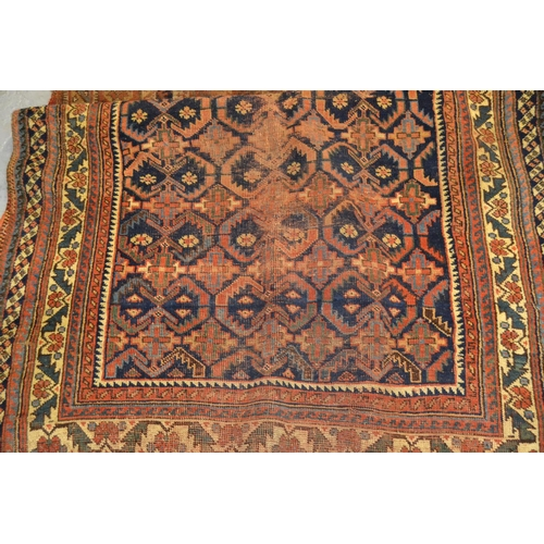 9 - Afshar rug with an all-over repeating design on a blue ground with borders (worn), 181cms x 120cms...