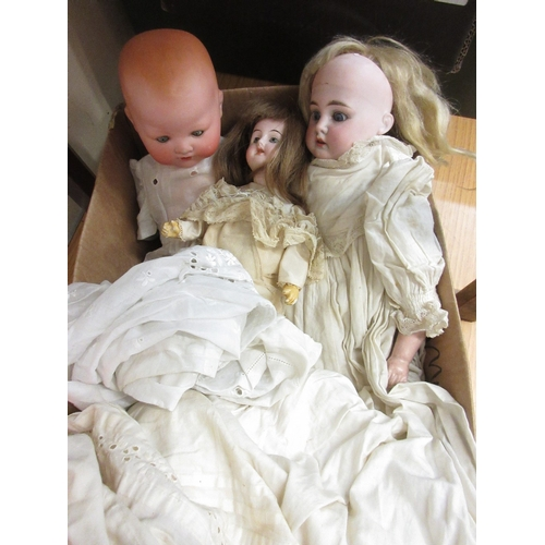 70 - Small Armand Marseille bisque headed baby doll (at fault), together with another small German bisque...