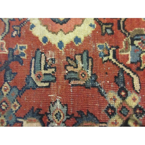 8 - Mahal carpet with a medallion and all-over stylised floral design on a red ground with borders (slig...