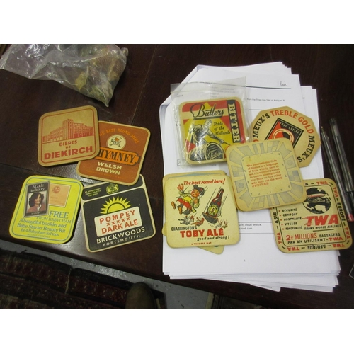 142 - Quantity of 1950's and later beer mats, together with a small quantity of Wade figures...