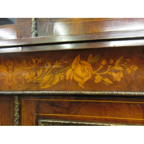 1892 - Victorian figured walnut marquetry inlaid and ormolu mounted bookcase, the moulded cornice above a p...