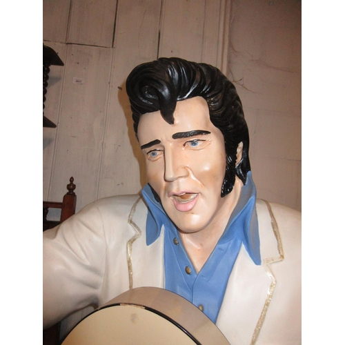 91 - Modern life size painted composition figure of Elvis Presley playing a guitar...