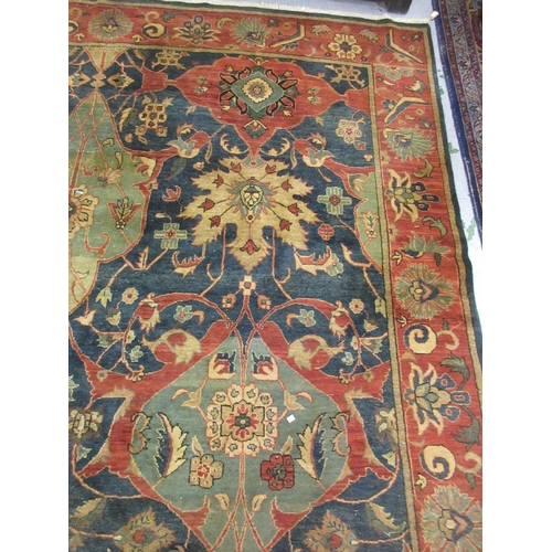 1 - Agra carpet of all-over floral design on burgundy ground with multiple borders, 119ins x 167ins...