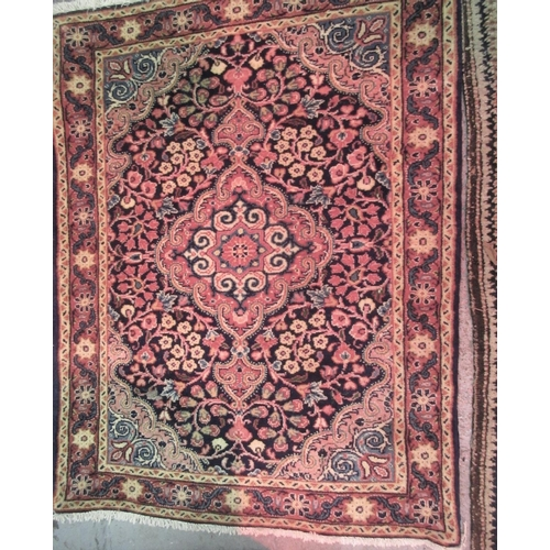12 - Small modern Tabriz mat with a medallion and all-over floral design on a midnight blue ground with b...