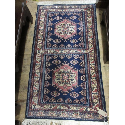 19 - Small Pakistan rug with a single medallion design on a blue ground, 3ft square approximately, togeth...