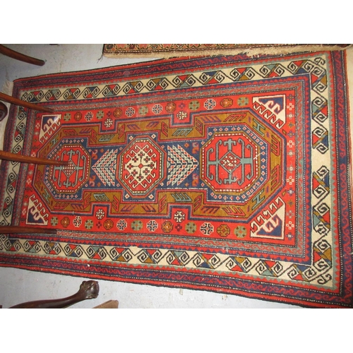 22 - Small Turkish rug with a triple hooked medallion Caucasian design on a rust ground, 5ft x 3ft 2ins a...
