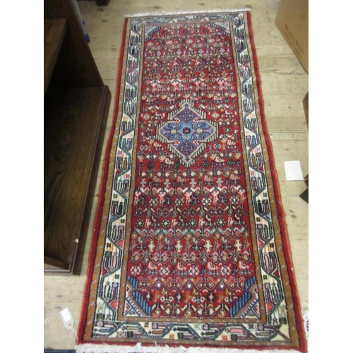 23 - Modern Hamadan rug with a medallion and all-over Herati design on a red ground, 6ft x 2ft 8ins appro...
