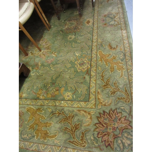 28 - Egyptian Royal Agra pattern carpet on green ground, approximately 9ft x 11ft...