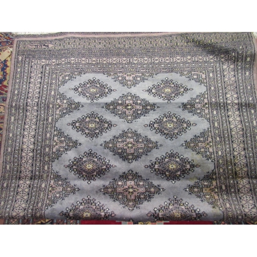 30 - Pakistan rug of Turkoman design with a single row of gols on a grey ground, together with another si...