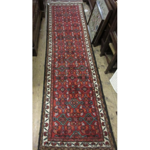 32 - Small Hamadan runner with all-over Herati design on a red ground with borders...