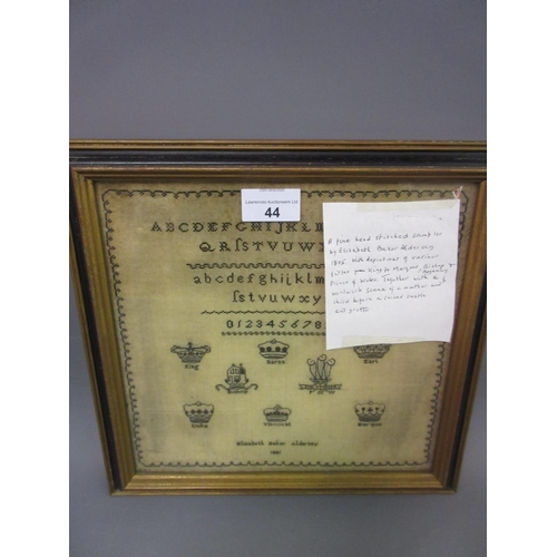 44 - Small 18th Century monochrome sampler with a panel of alphabet and numerals above crests of the nobi...