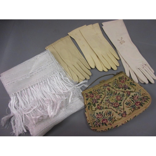 45 - Three pairs of ladies gloves, needlework evening purse, scarf, two under skirts and a bed cover...