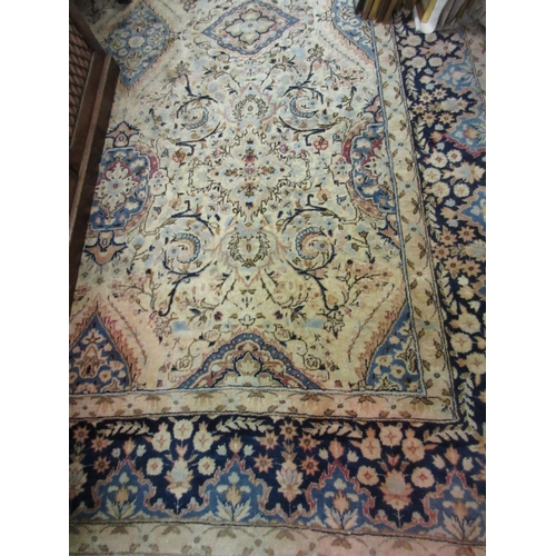 5 - Sparta carpet with an all-over medallion and floral design with borders on an ivory ground, 138ins x...