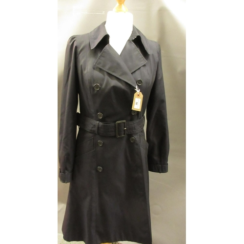 58 - Aquascutum ladies navy blue trench coat, size 12, together with a black Orla Kiely coat with belt, s...