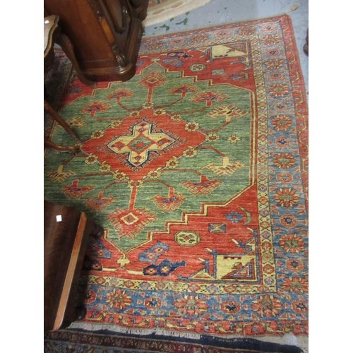 6 - Afghan rug of Kurdish design with a single central medallion in shades of brick red, green and blue,...