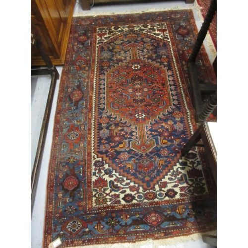 9 - Hamadan rug with a lobed medallion and all-over stylised floral design predominantly in shades of re...