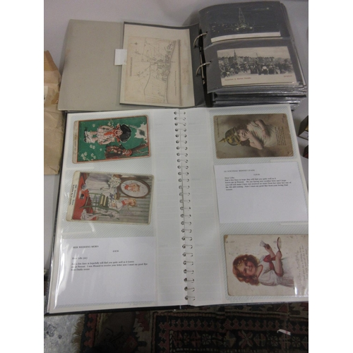 112 - Two albums containing a large collection of various 19th and 20th Century topographical postcards in...