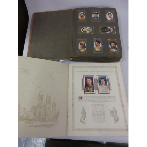 121 - Album of various postcards including Ogdens and Wills, together with a Coronation cigarette card alb...