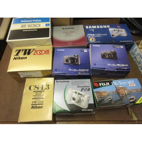 133 - Quantity of modern cameras including Nikon, Canon and Fuji, all in original boxes...