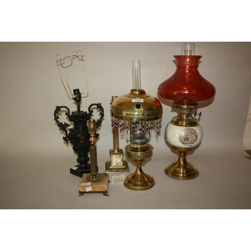 1714 - Small brass oil lamp with brass and tasselled shade decorated with jewelling, a dark patinated vase ...