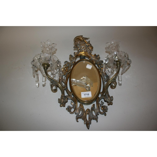 1715 - 19th Century gilt brass wall sconce of oval pierced form with a bevelled plate, the twin arm candle ...