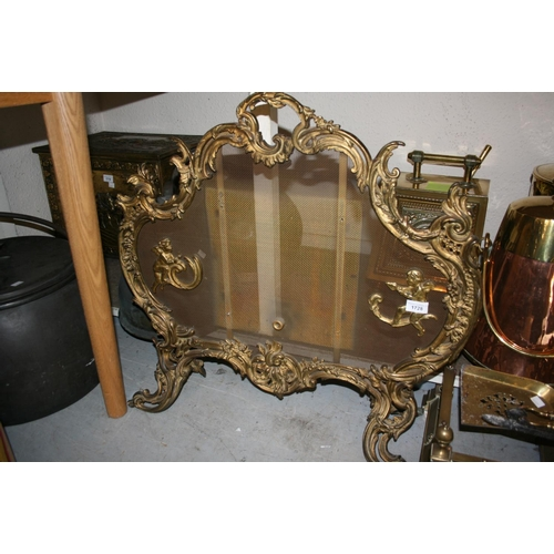 1728 - Early 20th Century gilt brass firescreen of rococo design...