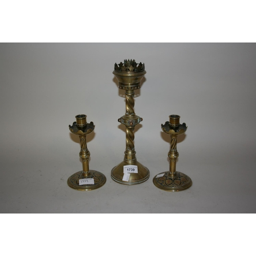 1739 - Victorian Gothic Revival candlestick, together with a pair of similar smaller candlesticks...
