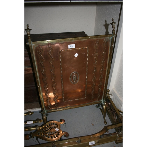 1742 - Arts and Crafts brass framed firescreen with copper embossed panel, 30ins high x 20ins wide...