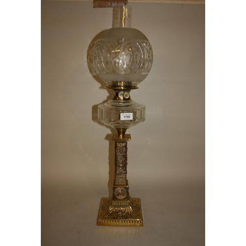1755 - Good quality Victorian brass oil lamp, the glass well above a square tapering column support decorat...