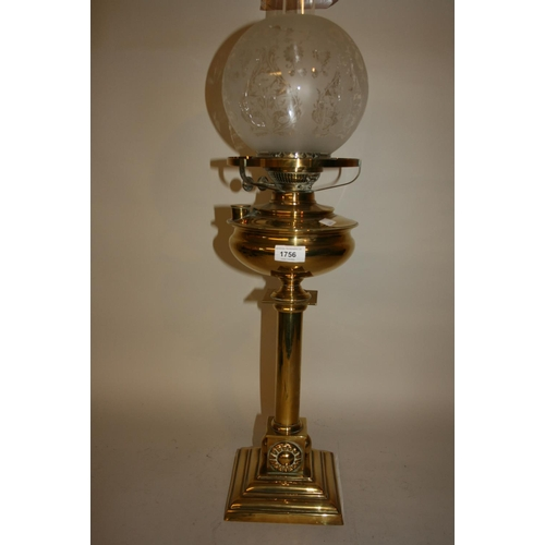 1756 - Arts and Crafts brass oil lamp, the brass well above a plain column support with stylised appliques ...