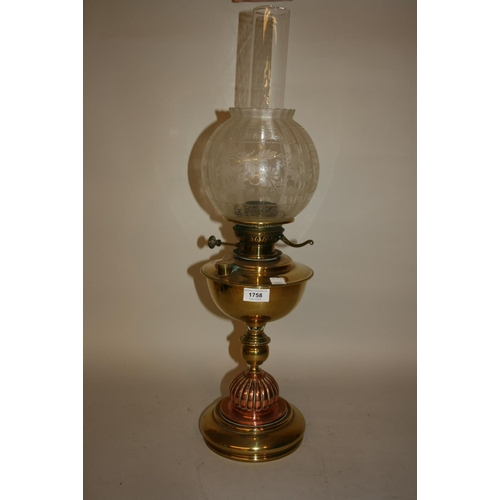 1758 - Arts and Crafts brass and copper baluster form oil lamp with etched glass shade and chimney...