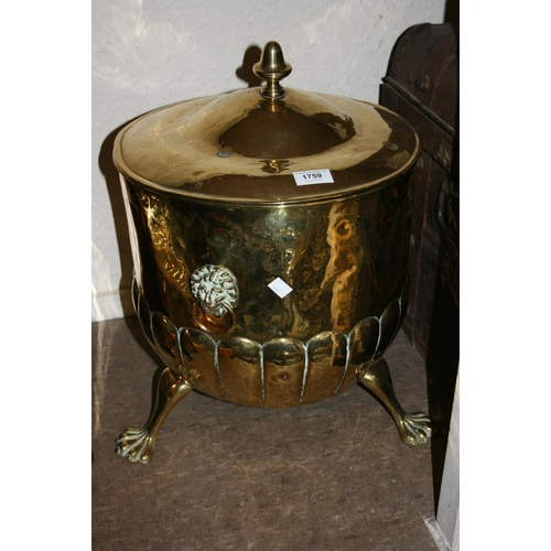 1759 - 19th Century brass coal purdonium with lid, lion mask side handles and paw supports...