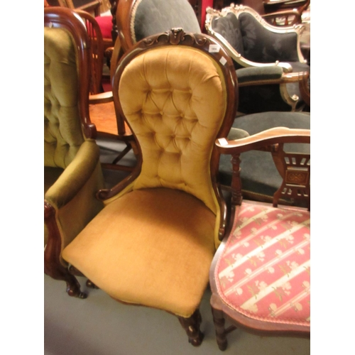 1904 - Victorian carved walnut and button upholstered low seat nursing chair with gold upholstery and cabri...