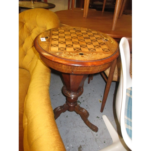 1908 - Victorian walnut and marquetry inlaid games / work table, the circular hinged lid inlaid with a ches...