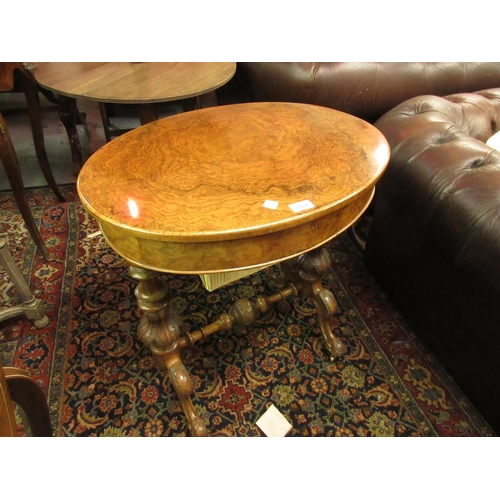 1914 - Victorian figured walnut work table, the oval hinged top above a wool compartment, turned and carved...