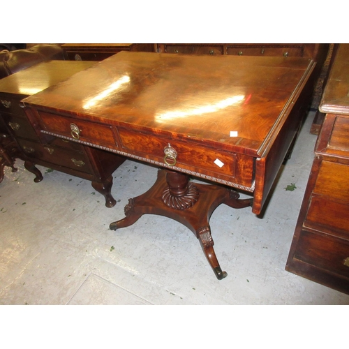 1917 - Regency figured mahogany and crossbanded drop-leaf sofa table with two drawers and brass ring handle...