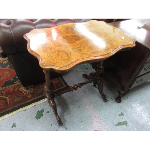 1923 - Victorian figured walnut occasional table, the shaped top above baluster turned supports, shaped fee...