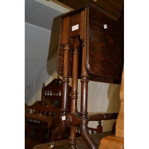 1924 - Victorian walnut octagonal trumpet form work table (at fault), a small Edwardian oak Sutherland tabl...