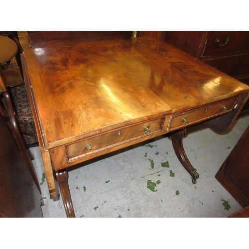 1929 - Regency mahogany drop-leaf sofa table, the figured top above two frieze drawers raised on rectangula...