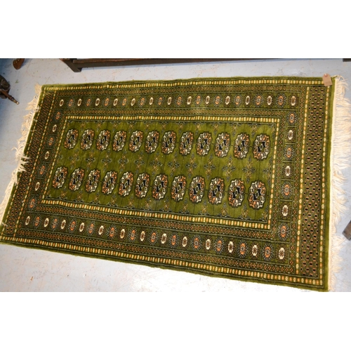 2 - Afghan gold ground rug with five gols, 6ft 6ins x 3ft 6ins approximately together with a Pakistan Bo...