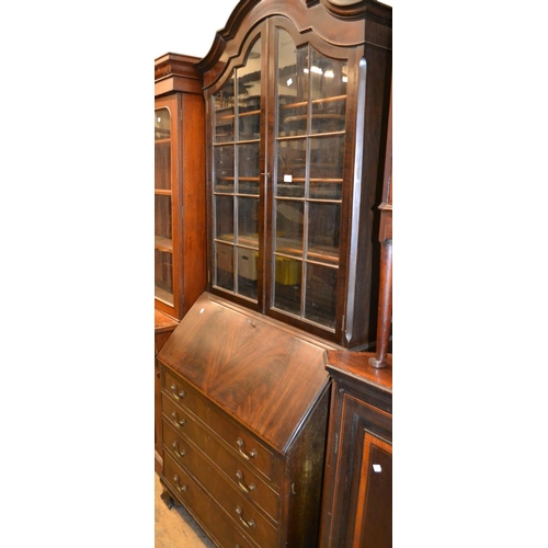 2389 - 1920's Mahogany dome top bureau bookcase with two glazed doors above a fall front and four graduated...