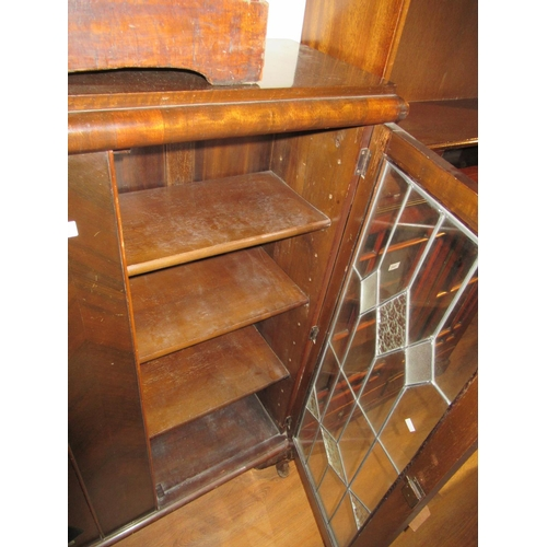 2393 - 20th Century mahogany two door bookcase with leaded glazed doors, raised on cabriole supports...