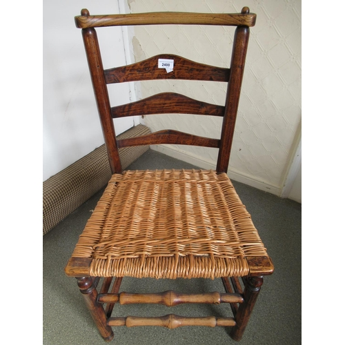 2400 - 18th Century elm ladder back side chair and an oak rectangular occasional table on slab end supports...