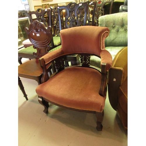 2411 - Late 19th or early 20th Century carved mahogany and pink upholstered tub shaped drawing room chair...