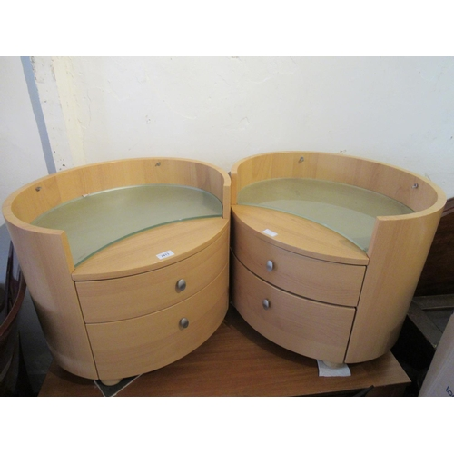 2413 - Pair of contemporary oval bedside cabinets, each with a crescent shaped glass top above two drawers...