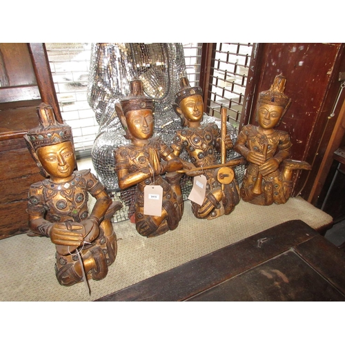 2415 - Set of four 20th Century Indonesian carved and gilded figures of musicians with jewelled and mirrore...